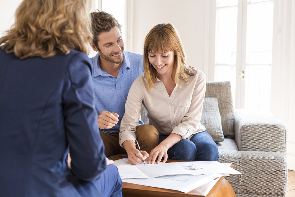 Couple signing up for Construction Home Loans with Mortgage World Australia