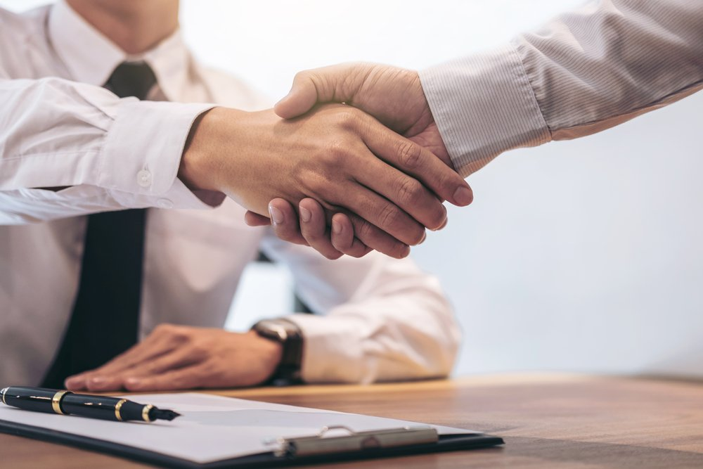 Shaking hands on new Commercial Investment Loans