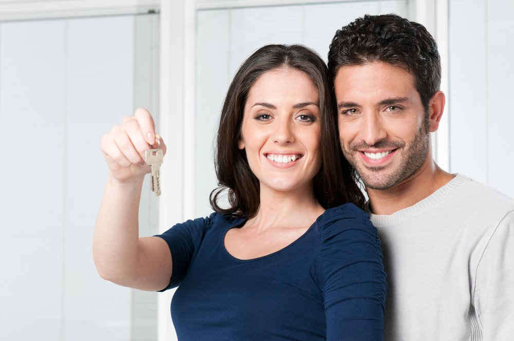 Couple showing new Residential Investment Keys